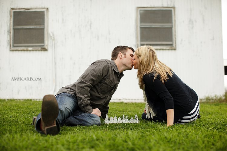 olivia and bobby's farm engagement session with a horse and chess set in ennis texas by dallas wedding photographer amy karp (10)
